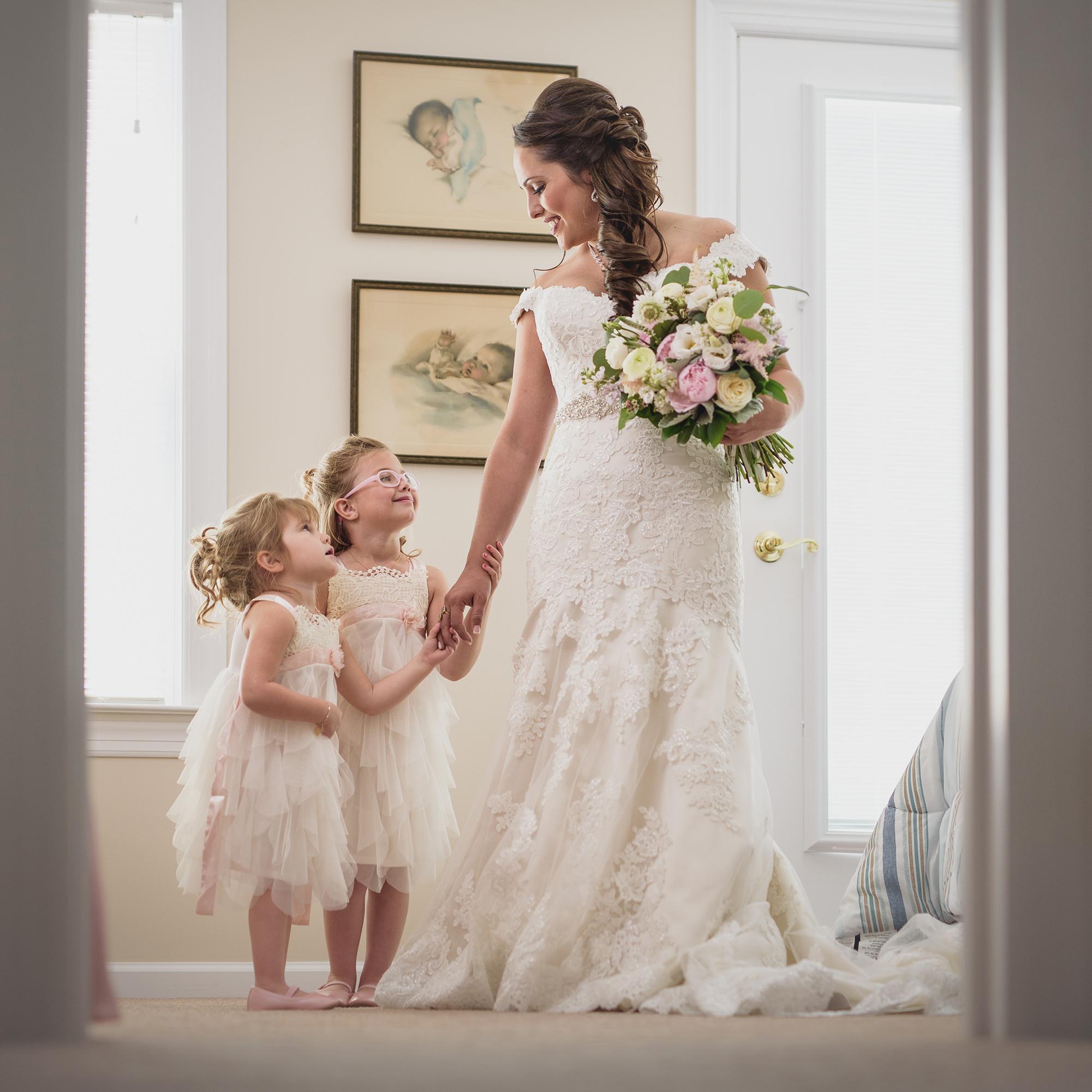 Bride looking down holding flowers