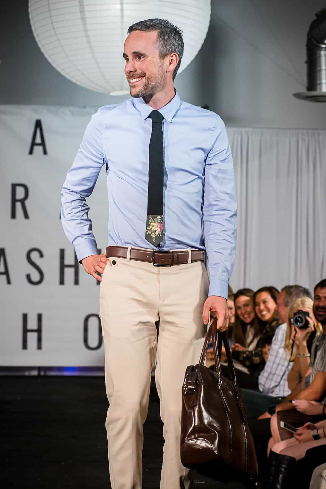 man modeling charles vane clothing in fashion show