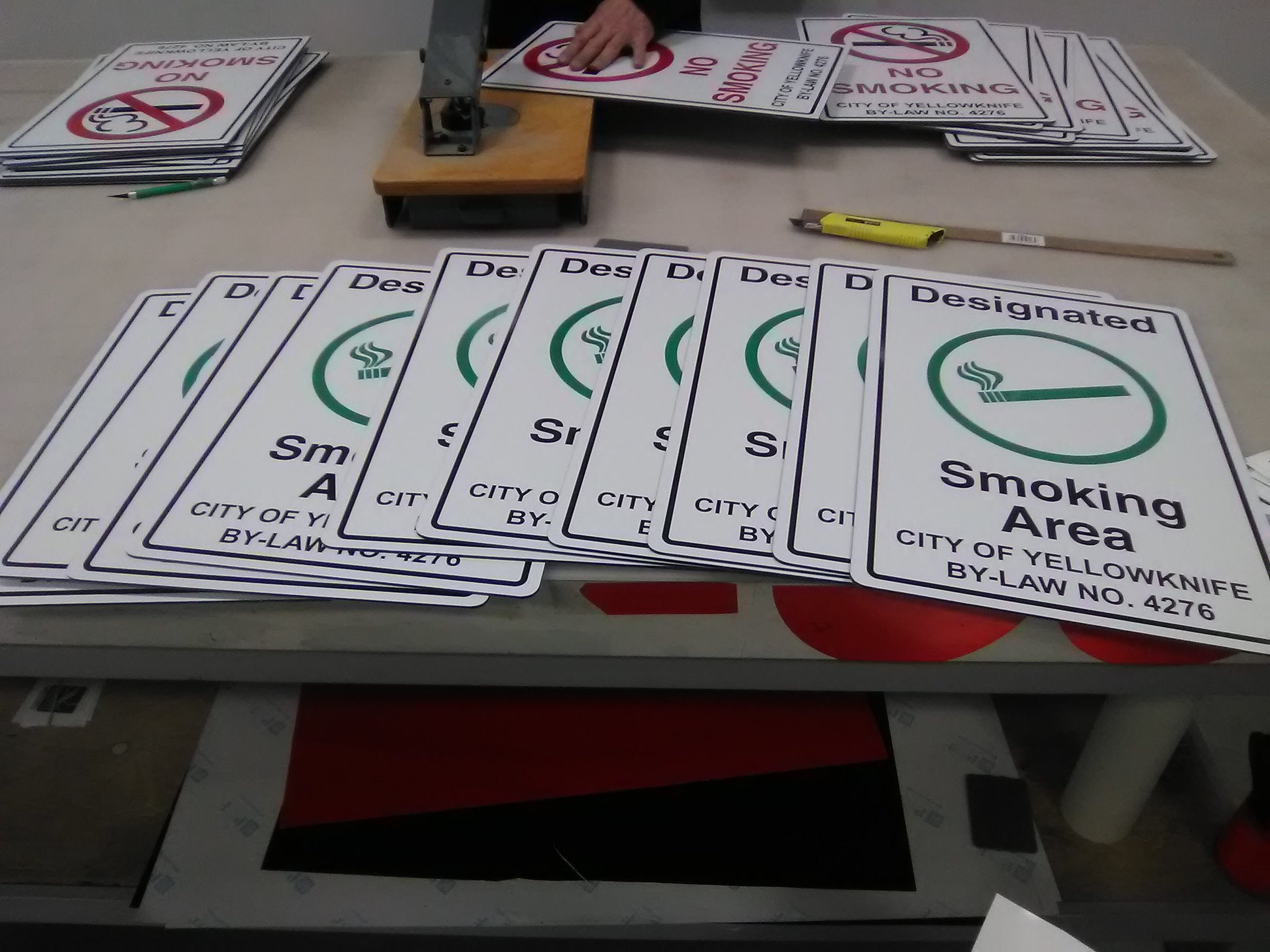 Exterior Signage for designated smoking and non-smoking areas.