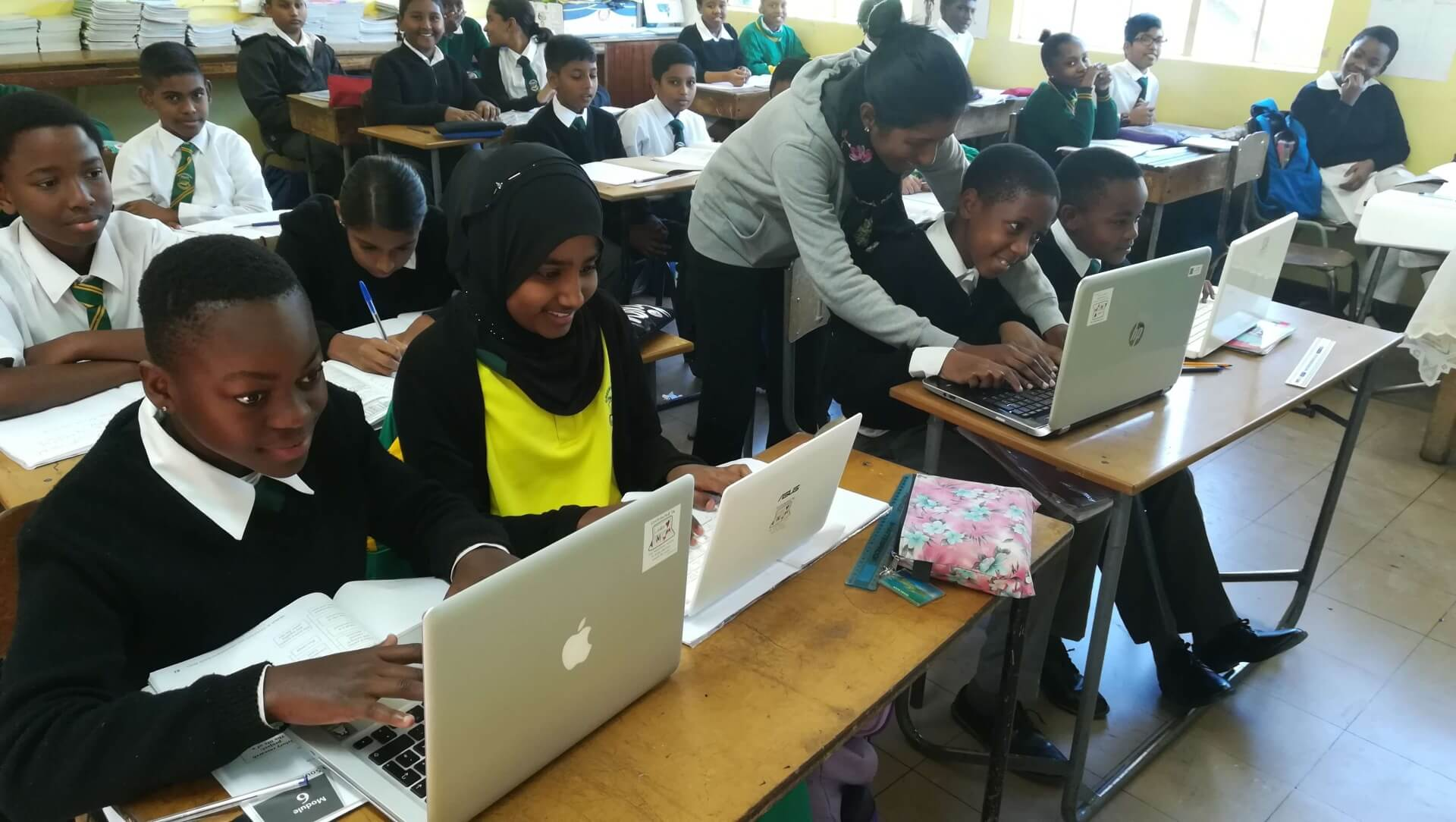 School children in South Africa are happy about their donated lapotops