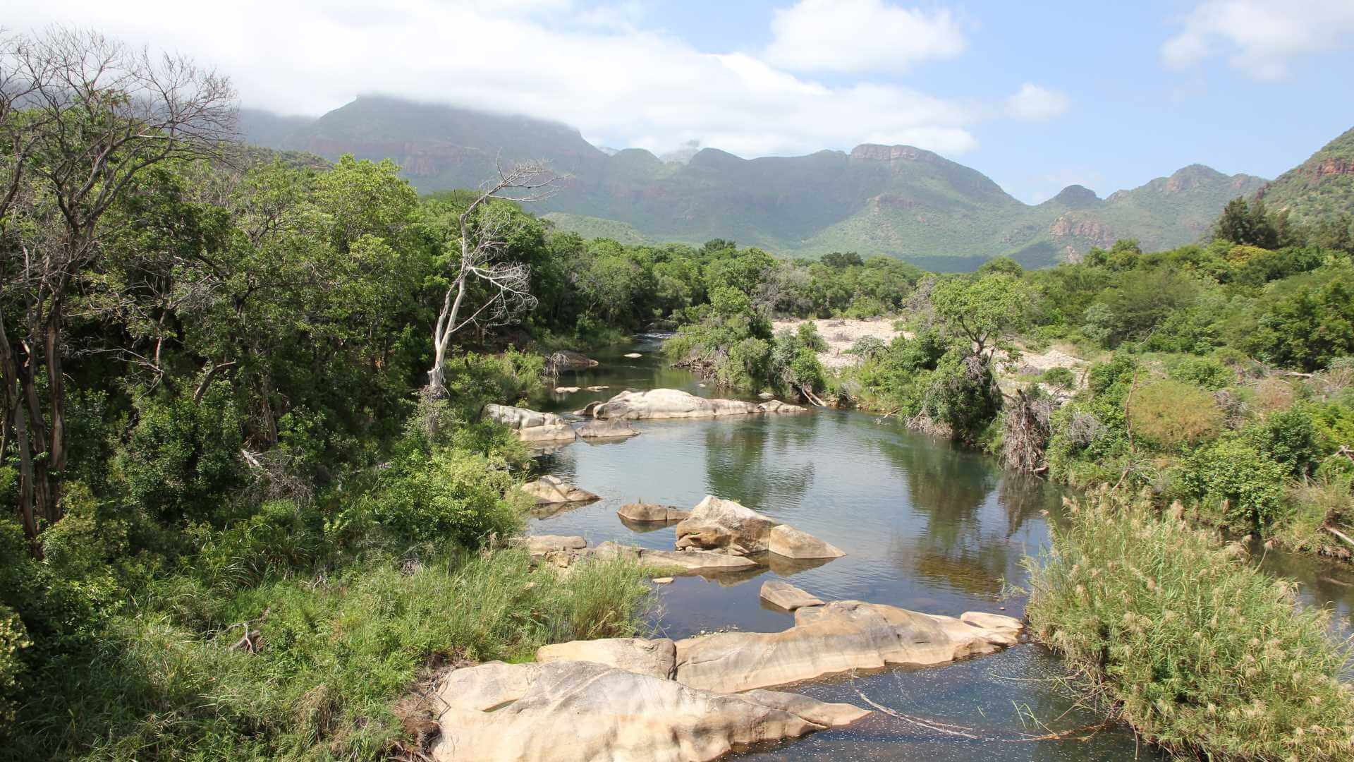 Gentle river in front of mountains, Blyde River, South Africa