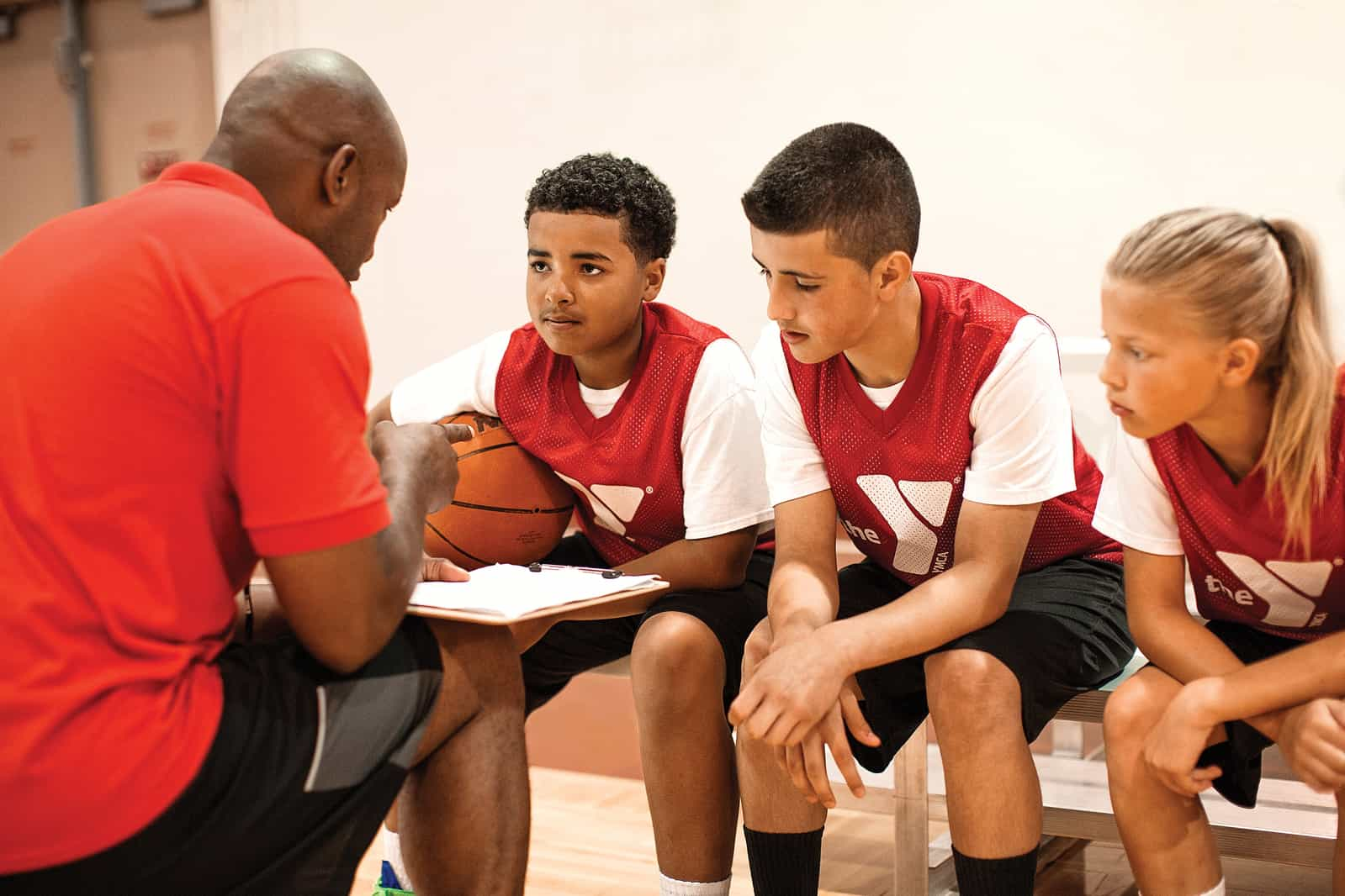 Coach instructing basketball athletes