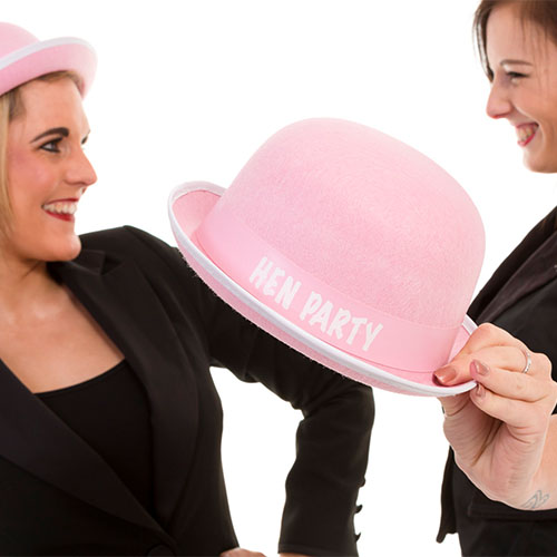 Amy Young Dance team wearing pink bowler hats for hen party activities