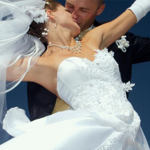 Dramatic image of couple dancing at wedding after wedding dance lessons with Amy Young Dance