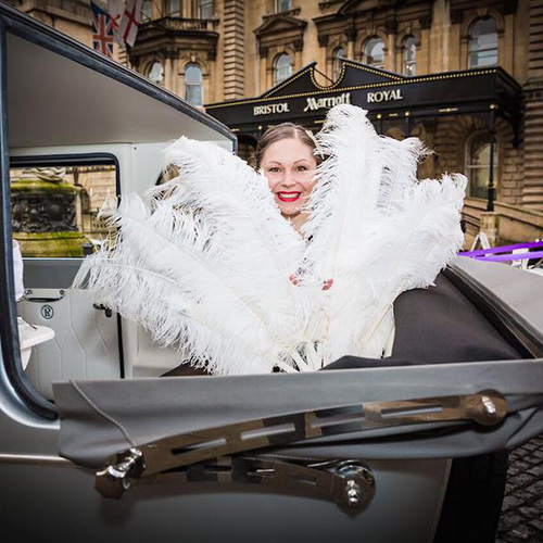 Amy Young dance wedding entertainment ideas bristol. Image of woman with feathers.