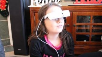 Santa Gives a Visually Impaired Girl eSight for Christmas