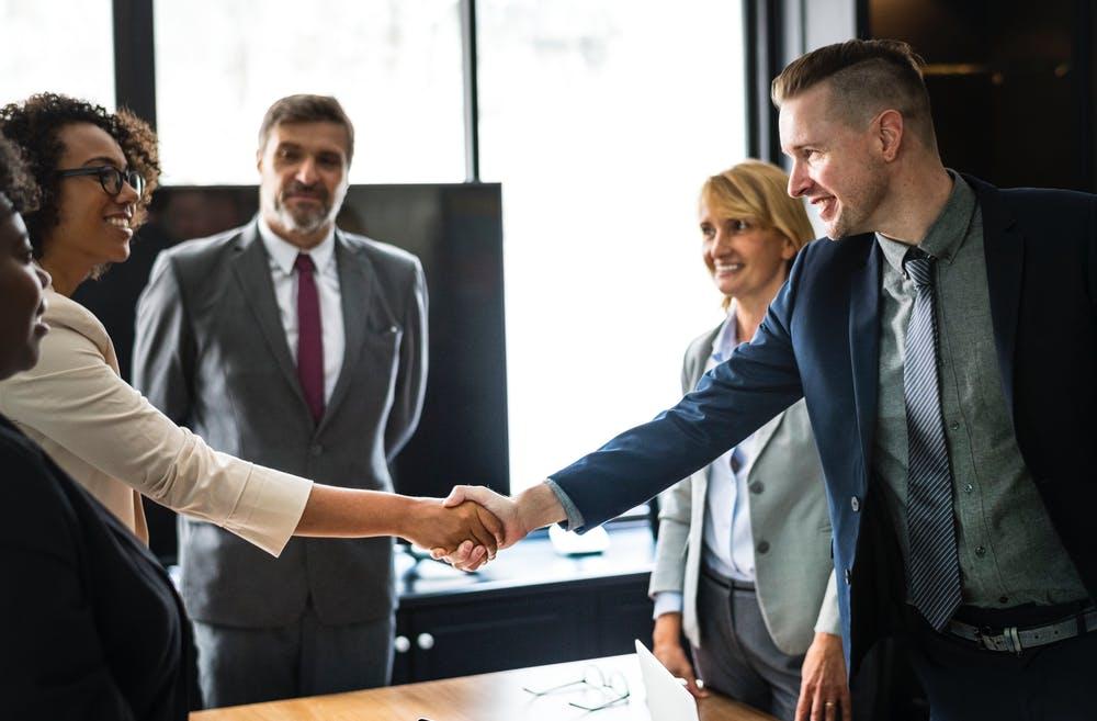work meeting people shaking hands