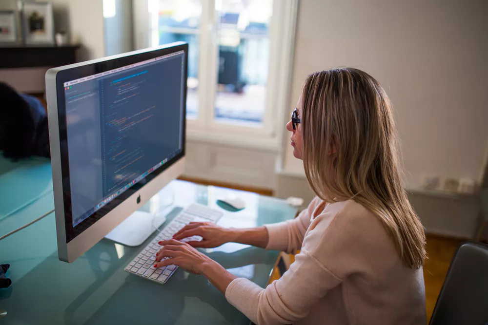 Woman coding on a computer