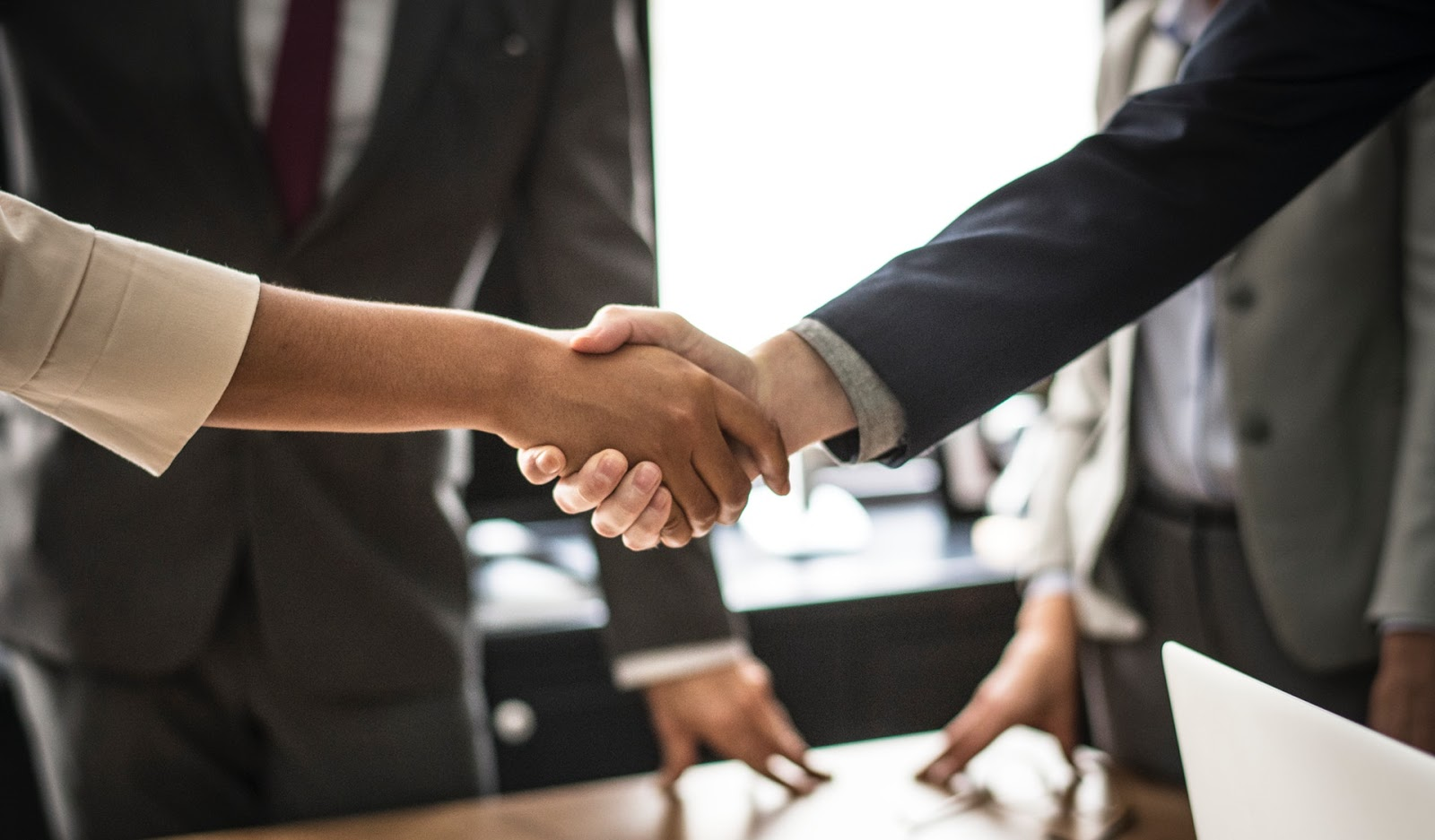 shaking hands at an IT staffing agency