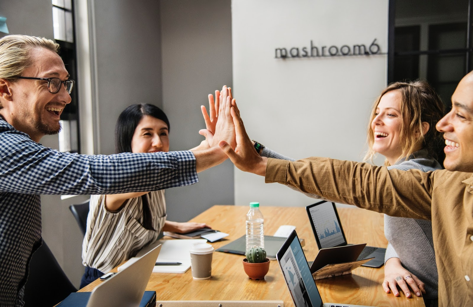 high five at an IT staffing agency