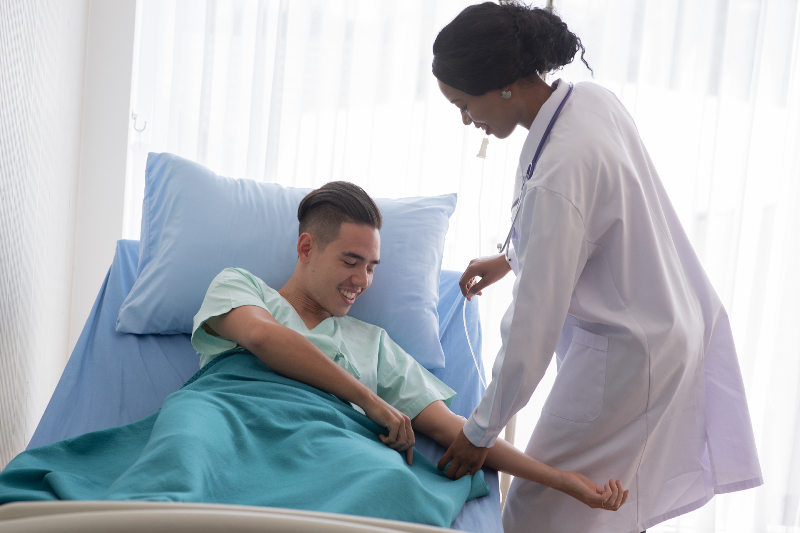 Female Doctor with Male Patient in Hospital
