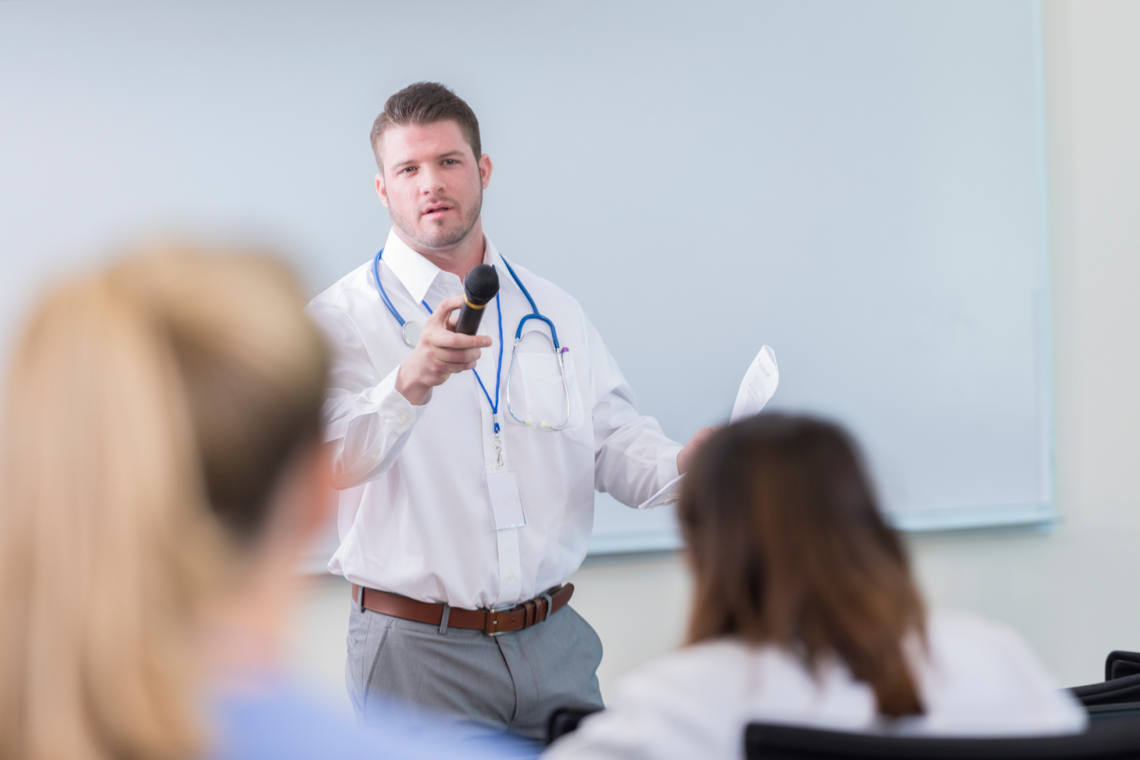 man speaking to medical class