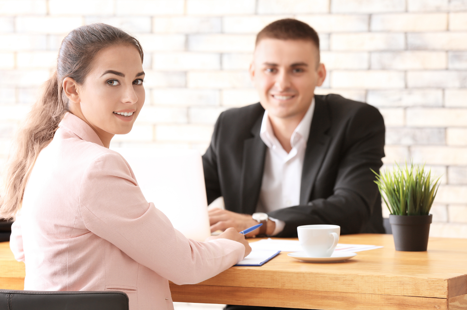 Human Resources Manager Interviewing Woman at Table