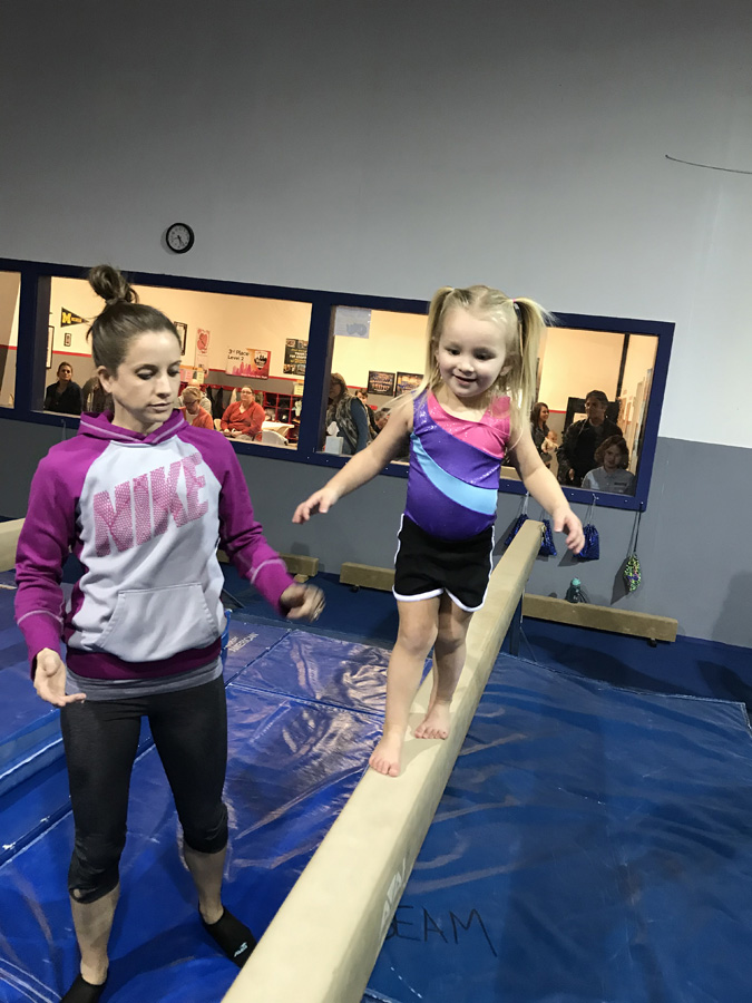 Learning to balance walking the beam during the 4-5 Year Old class at Indiana Gymnastics Center