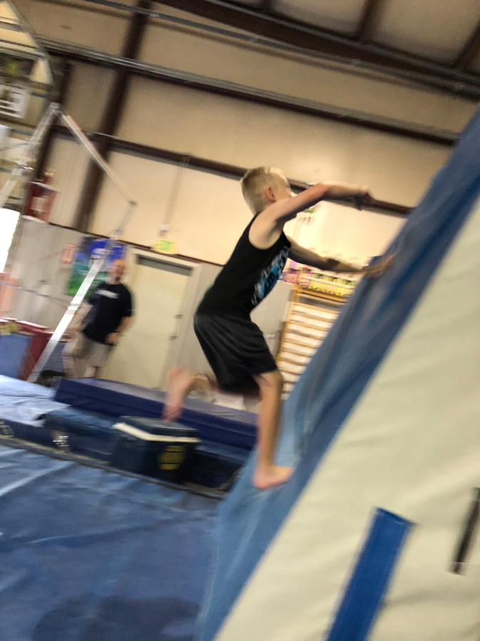 Boy climbing warp wall