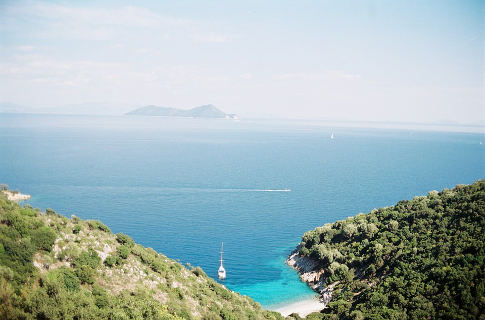 A Journey Through yacht anchored in a bay in the Greek Ionian