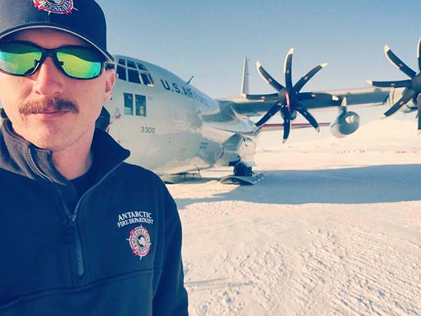 Image of Buddy Pearce in front of Plane in Antartica