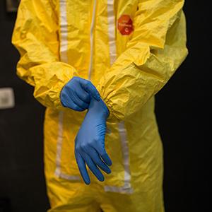 Image of a person in a HAZMAT Suit