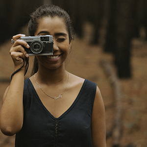 Image of woman holding a camera.