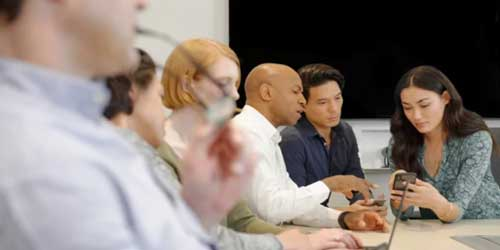 Image of group of people in a meeting at a table