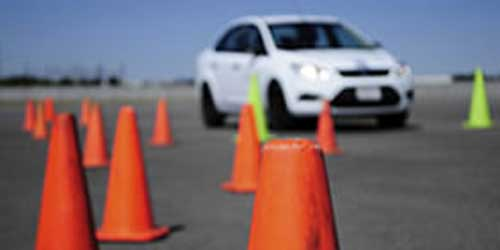 Image of car driving around safety cones.