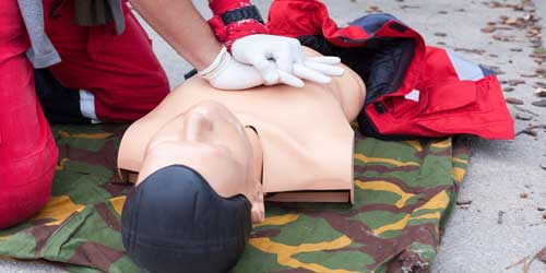Image of a person practicing CPR on a mannequin