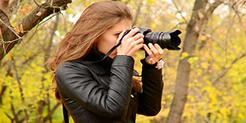 Image of a lady taking a photo with her camera