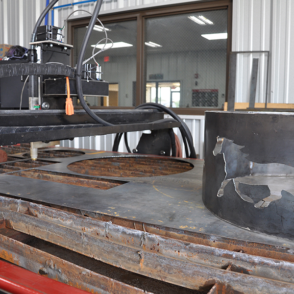 Image of a plasma cutting table in the welding shop