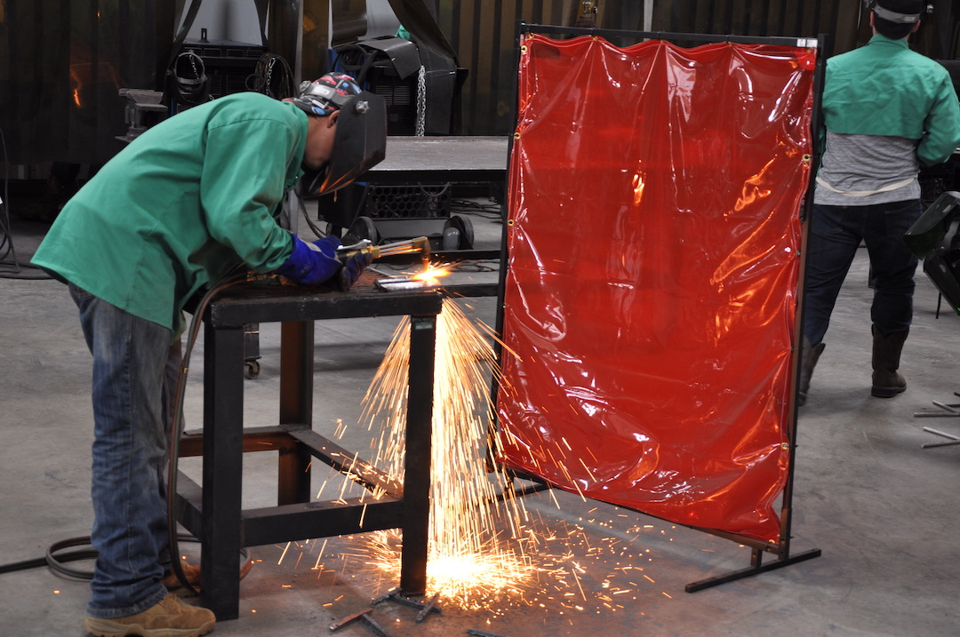 Image of a student using a cutting torch