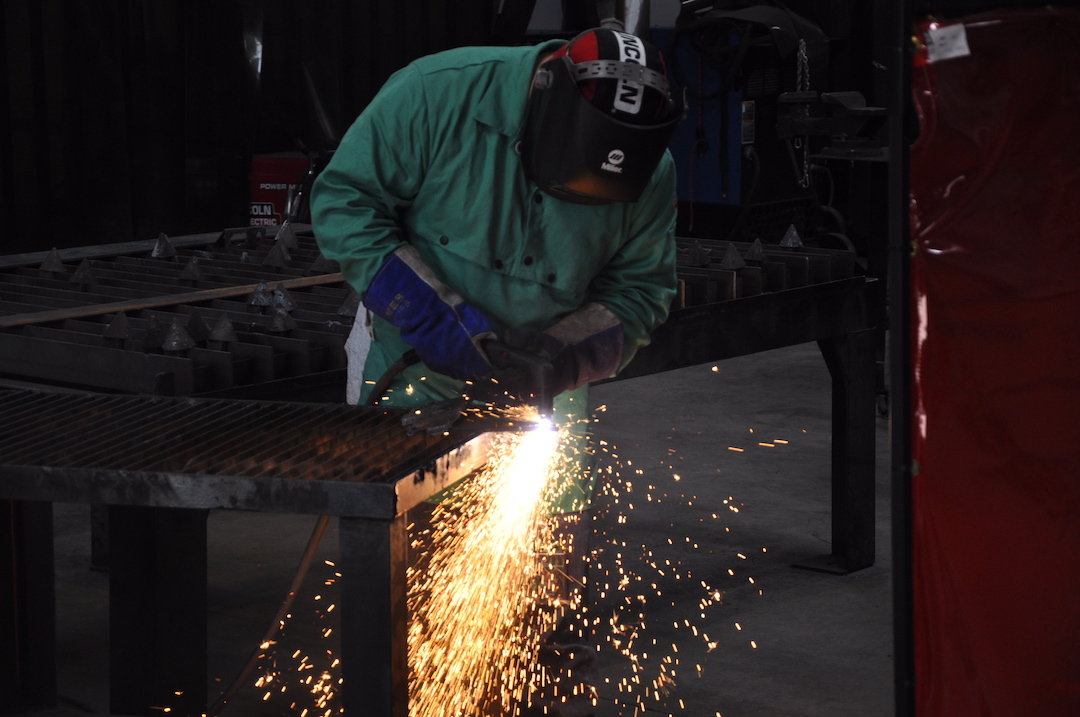 Image of student welding with sparks flying