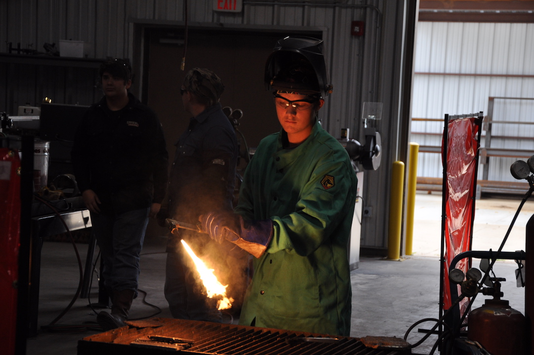 Image of student using cutting torch