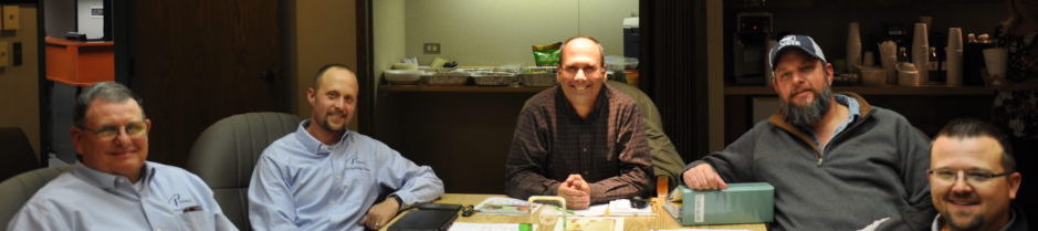 Group photo of five board members.