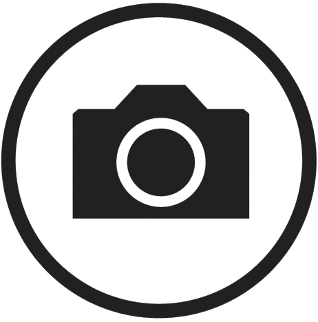 Icon of a camera logo inside a circle.