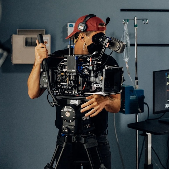 Man operating a movie camera