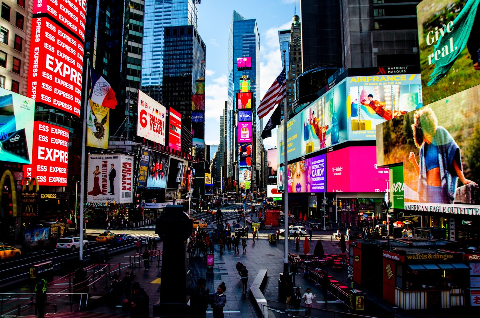 Digital advertisements line a busy cityscape, showcasing the importance of brand awareness.
