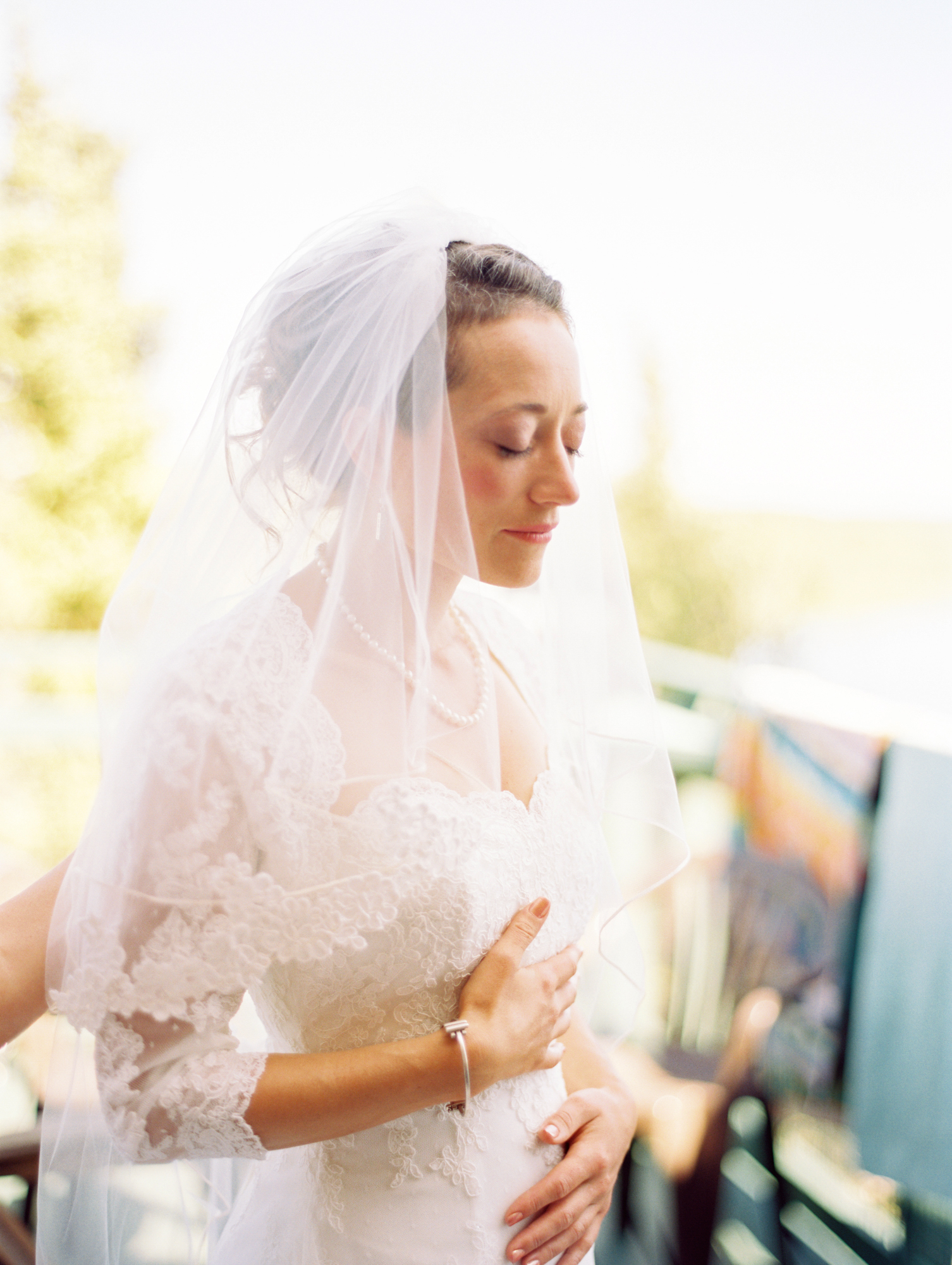 Bride taking a moment before wedding ceremony