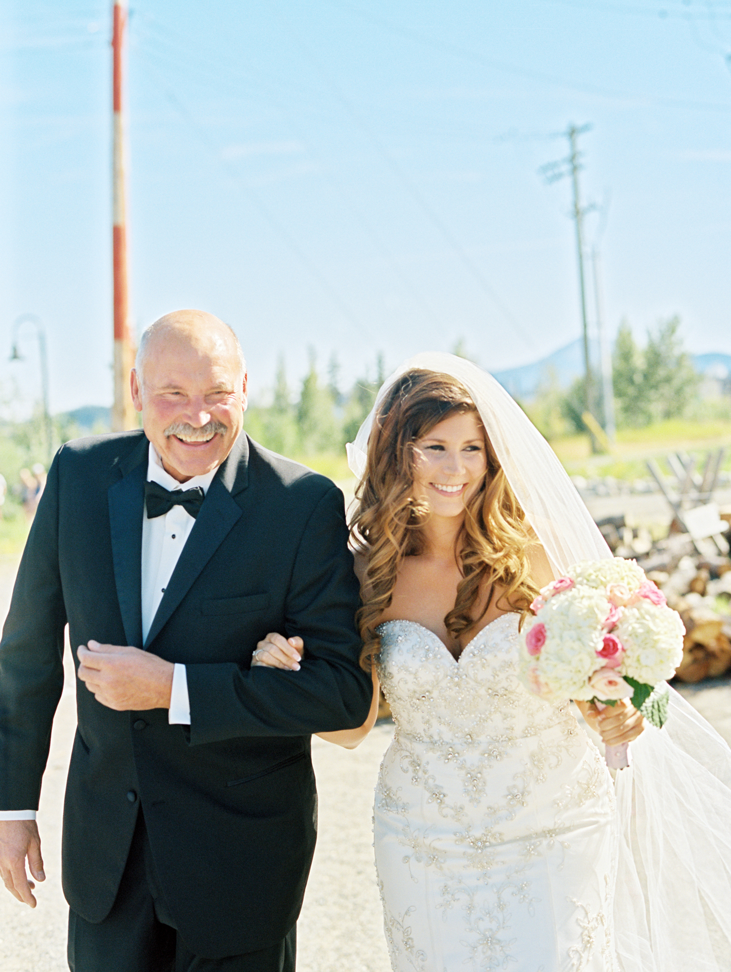 Father of the bride walking down the aisle