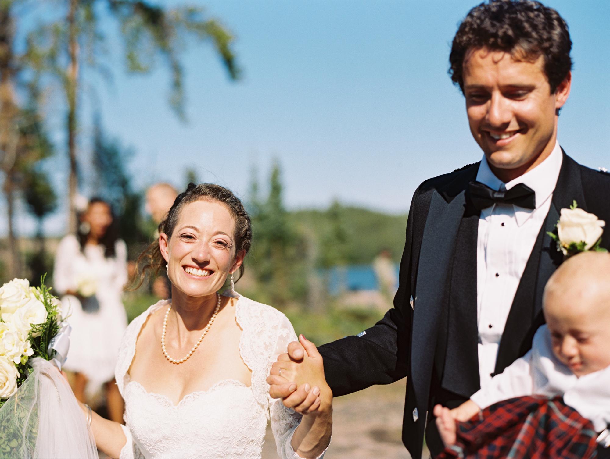 Bride and groom walking back after ceremony