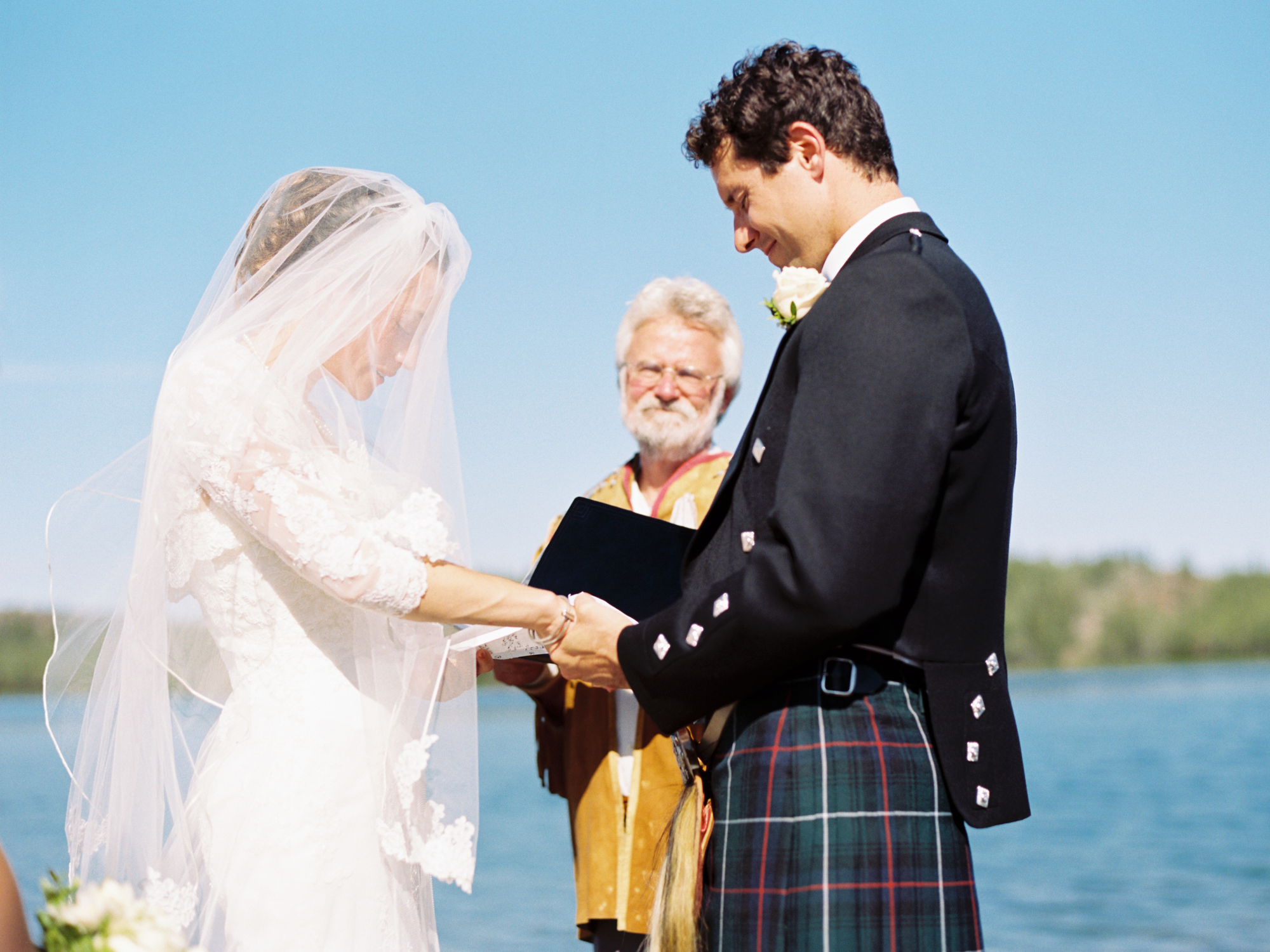 Bride and groom exchange vows on the shore of Blatchford Lake, NWT