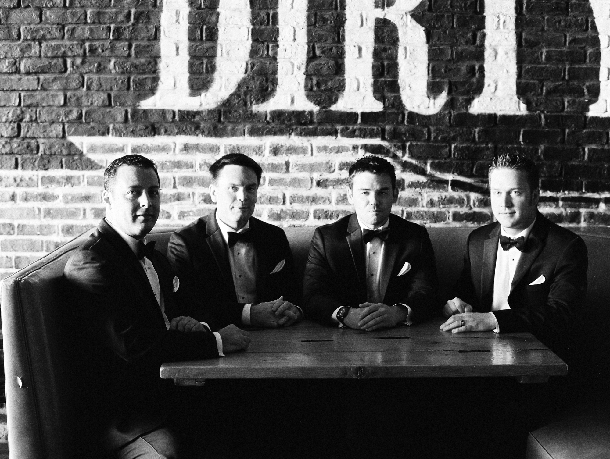 Groom and groomsmen at the Dirty Northern in Whitehorse, Yukon