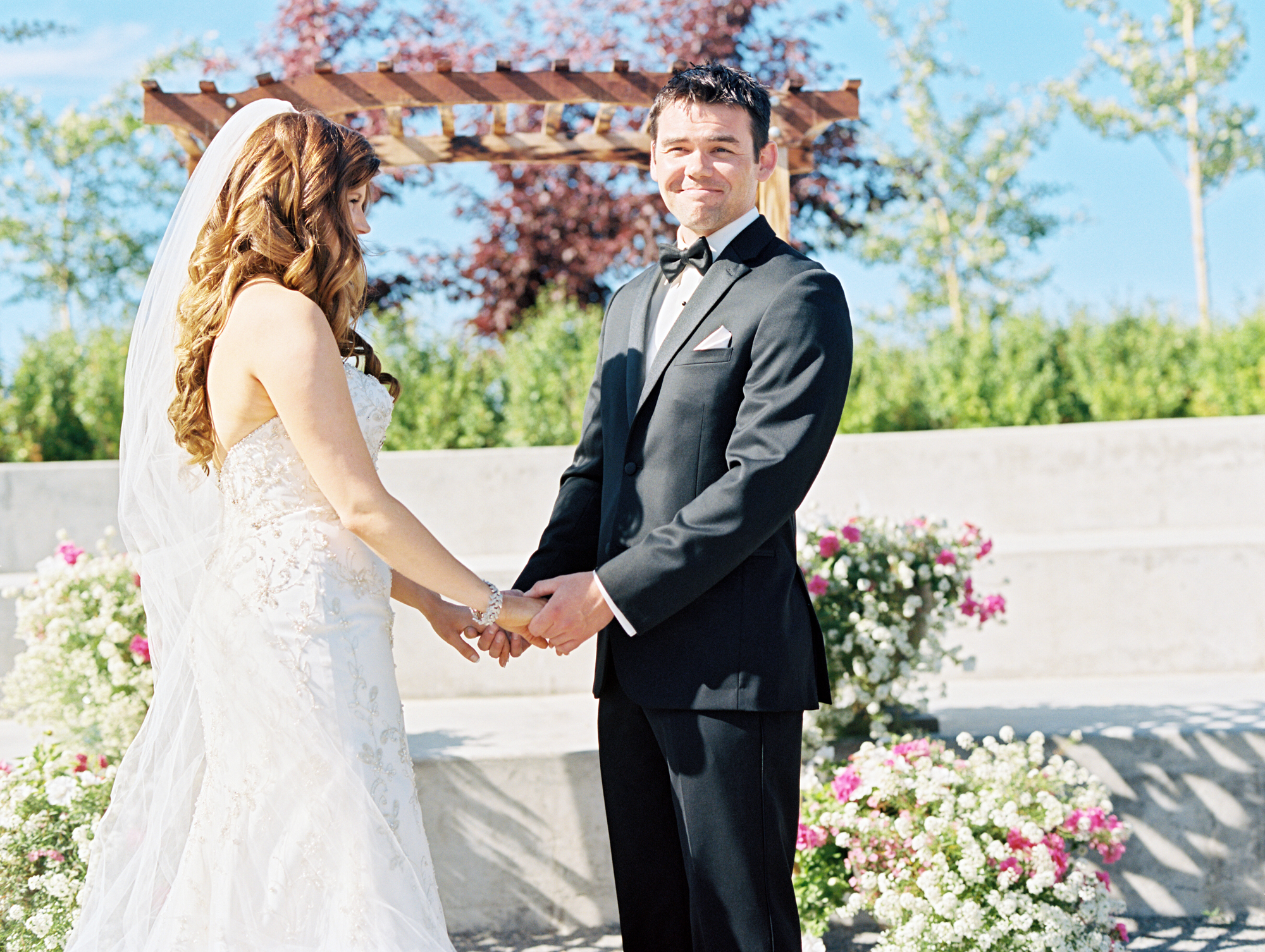 Bride and groom exchanging vows during wedding ceremony