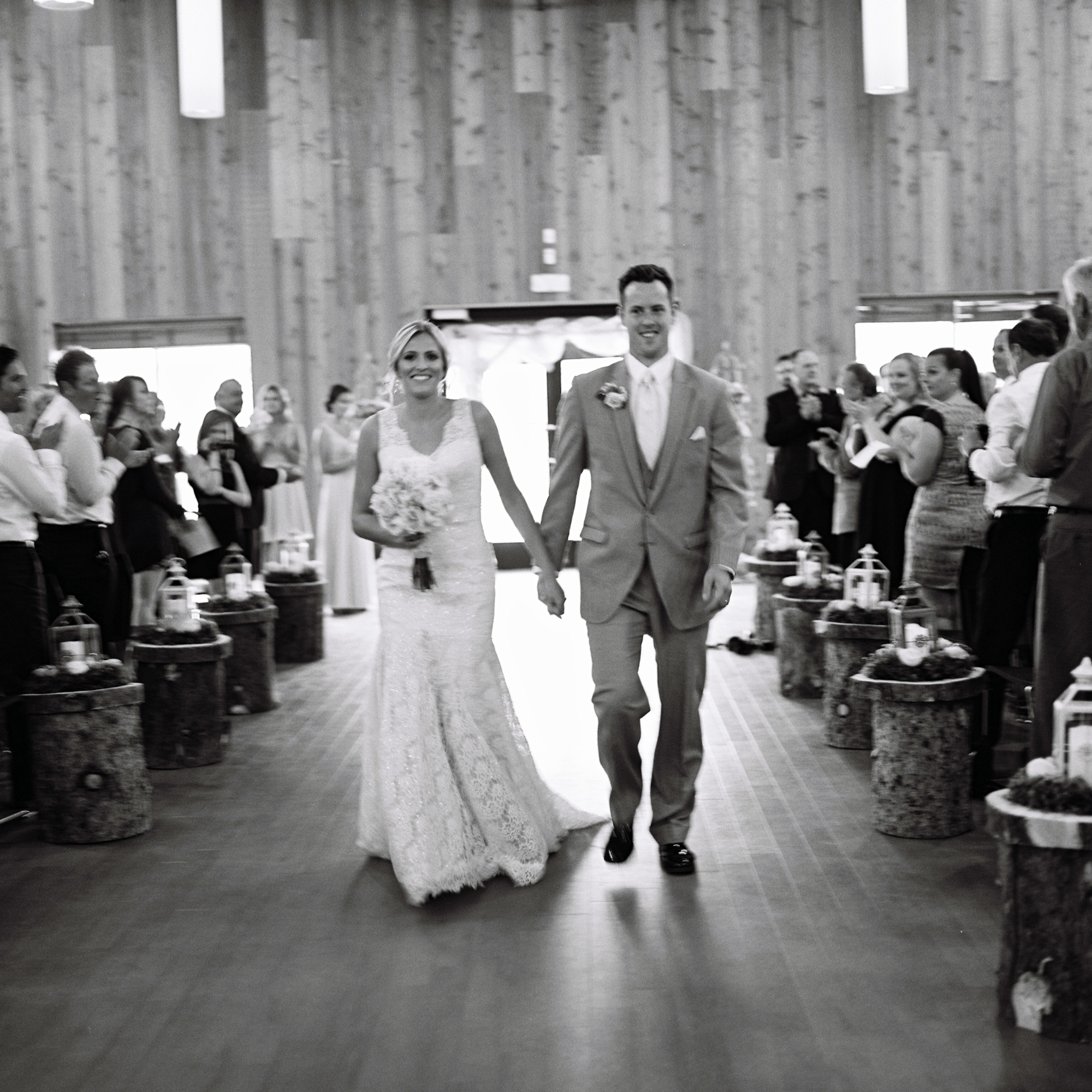 Bride and groom walking down aisle after wedding ceremony