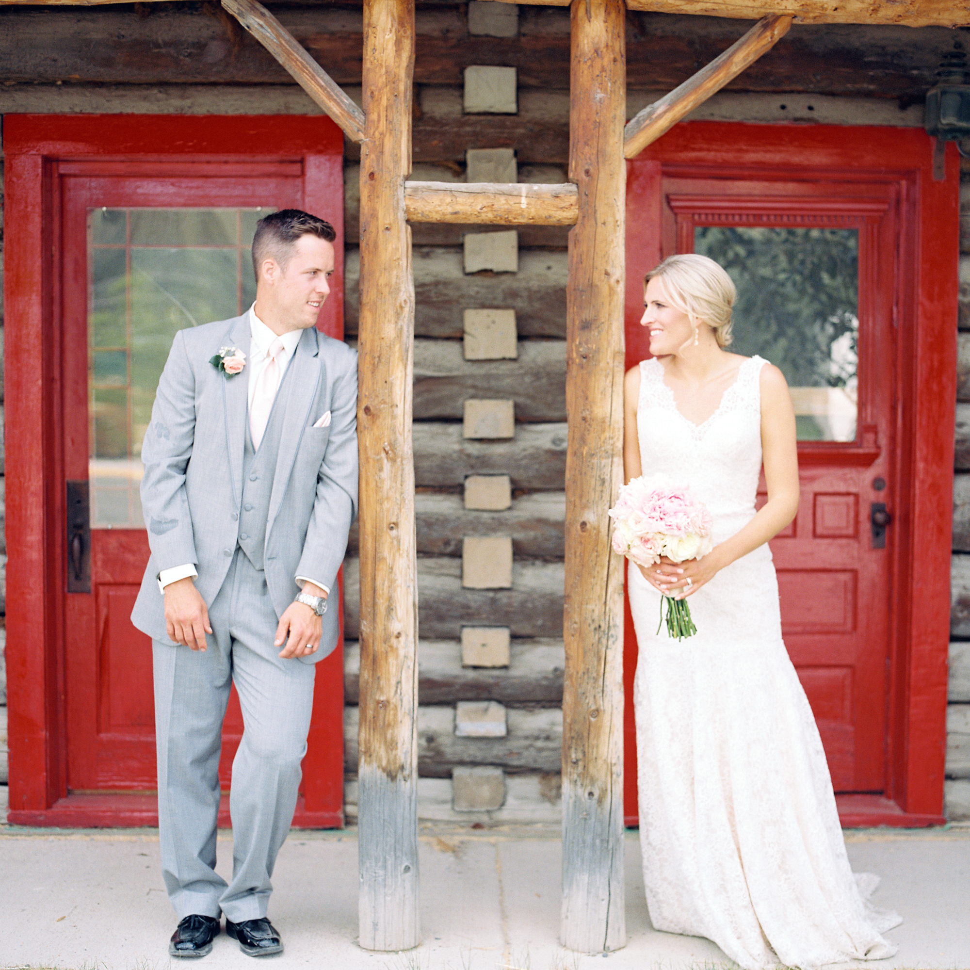 Bride and groom in front of old building in Whitehorse, Yukon