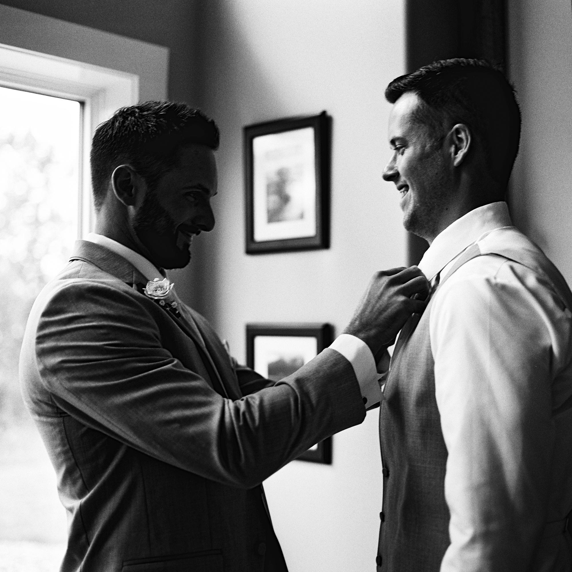 Groomsman fix groom's tie