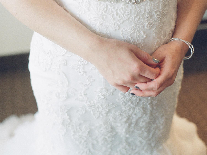 Detail shot of bride in her dress  in Kamloops at Hotel 540 wedding