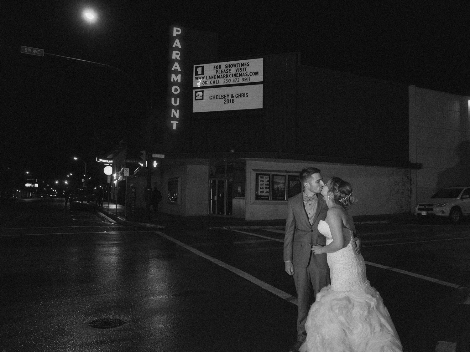 Bride and groom in front of Paramount in Kamloops, BC.