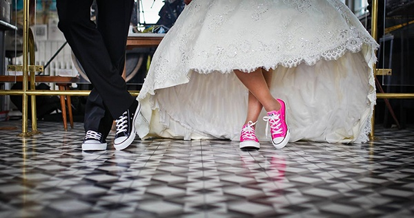 Couple wearing trainers in wedding outfits for dancing - Amy Young Dance