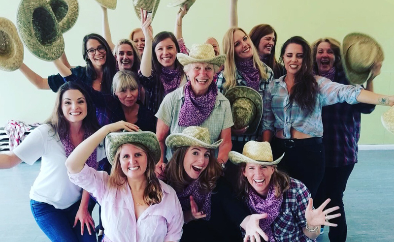 Amy Young dance class for Bath henparty- group of women waving cowgirl hats