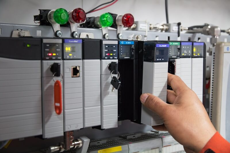 Picture of a person using a PLC