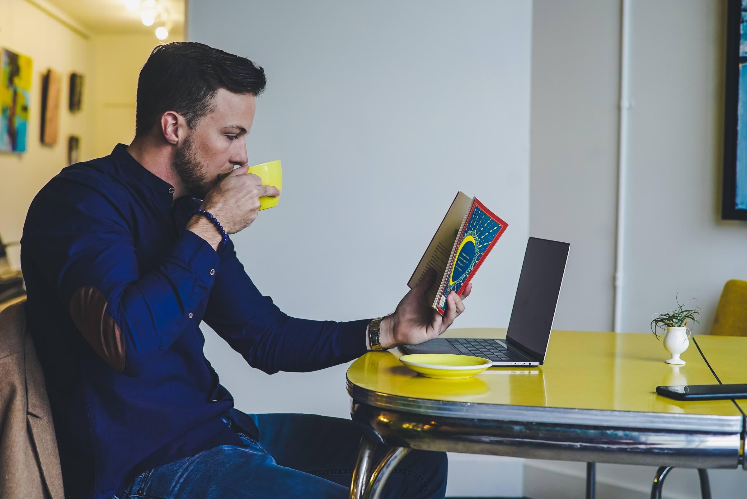 zestful blog image of happy male employee drinking coffee reading magazine
